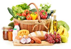assorted grocery products including vegetables fruits wine bread dairy and meat  - stock photo