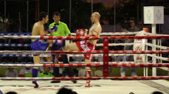 Two Foreign Muay Thai Kick Boxers Fight Stock Footage