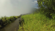 Mist Rising Over Path by Victoria Falls Stock Footage