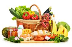 Assorted grocery products including vegetables fruits wine bread dairy and meat  Stock Photos