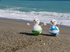Snowman beach vacation Stock Photos