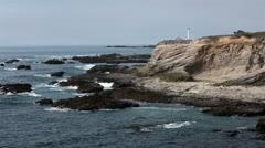 Rugged rocky ocean coast Point Area Lighhouse California HD 6225 Stock Footage