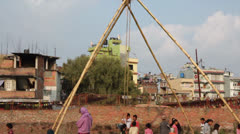 Brave child rides on a very big swing made from bamboo. Stock Footage