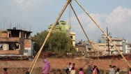 Stock Video Footage of Brave child rides on a very big swing made from bamboo.
