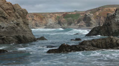 Rugged rocky Pacific Ocean point beautiful surf HD 5996 Stock Footage