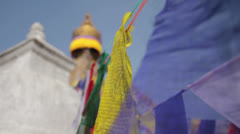 Colored flags fly near Boudha (Bouddhanath or Baudhanath) stupa in Nepal Stock Footage