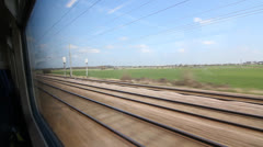 Stock Video Footage of Travelling by train in the UK. Sunny spring day.