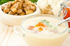 soup cauliflower puree with red caviar - stock photo