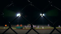 Football Stadium Behind Fence at Night - stock footage