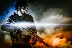 Assault soldier with rifle on apocalyptic clouds Stock Photos