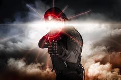 Soldier aiming assault rifle laser sight Stock Photos