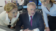 Diverse team of financial traders hard at work in a busy office Stock Footage