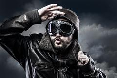 Stock Photo of pilot with glasses and vintage hat with funny expression
