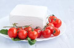 Cherry tomatoes and bulgarian white cheese - stock photo