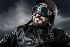 aviator with glasses and vintage hat with proud expression - stock photo