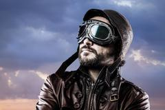 Stock Photo of aviator with glasses and vintage hat with proud expression