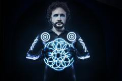 Man with blue neon lights, the future warrior costume, fantasy soldier Stock Photos