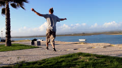 Man balancing and jumping, slackline Stock Footage