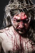 calvary jesus, man bleeding, representation of passion - stock photo