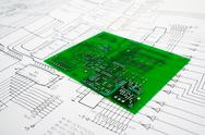 Stock Photo of printed circuit board and schematic