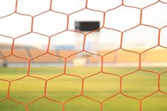 Net soccer goal football and green grass field Stock Photos