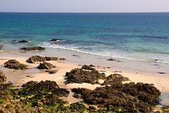 rocky beach in the atlantoc coast in brittany, france - stock photo