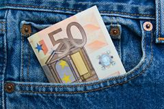 50 euro note in a blue jeans pocket - stock photo