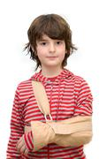 Boy with sling on broken arm Stock Photos