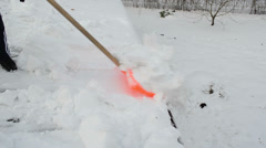 Closeup worker colorful shovel push snow roof. hard winter works Stock Footage