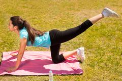 young beautiful woman stretching after sport - stock photo