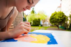 girl with brush painting an art image - stock photo