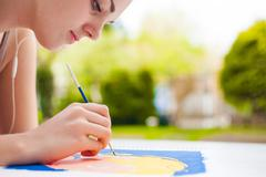 Girl with brush painting an art image Stock Photos