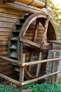 historic water mill wheel - stock photo