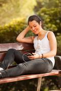 young latin woman using celphone - stock photo