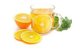tea break, orange tea with little  croissant - stock photo