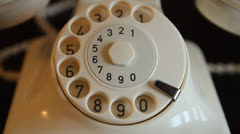 Vintage classic white phone. Woman dials 911 Stock Footage