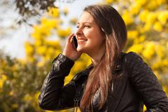 Young latin woman using celphone Stock Photos