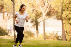Young beautiful woman jogging Stock Photos