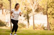 Stock Photo of young beautiful woman jogging