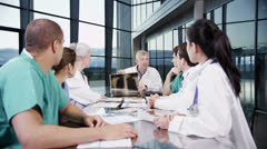 Multi ethnic medical team in a meeting discuss a patient's x-ray results Stock Footage