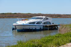 luxury pleasure boat moored at the pier - stock photo