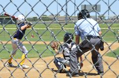 Little Leaque boys playing baseball - stock photo