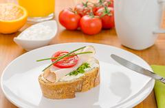 baguette with turkey breast on a breakfast table - stock photo