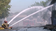FIREMEN AN FIREFIGHTERS PUTTING OUT BUILDING FIRE HD 1080 Stock Footage