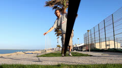 Man walking on a slackline Stock Footage