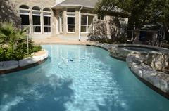 Upscale Backyard Swimming Pool - stock photo