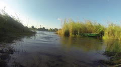 Low angle of water flowing towards camera in Zambezi River with reeds Stock Footage