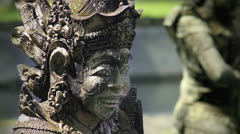 159 Balinese stone sculpture and glare of sunlight on it Stock Footage