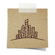 hand draw skyscraper on note taped recycle paper - stock photo