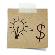 Hand draw lightbulb and dollar symbol on note taped recycle paper Stock Photos